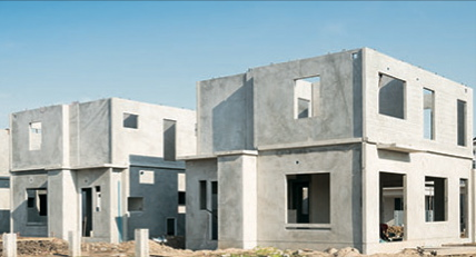 Fiber reinforced concrete walls of house under construction.