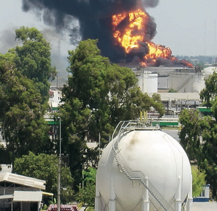 Blast and fire in concrete storage tanks at petroleum refinery.