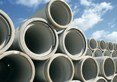 Stacked fiber-reinforced precast concrete pipes.