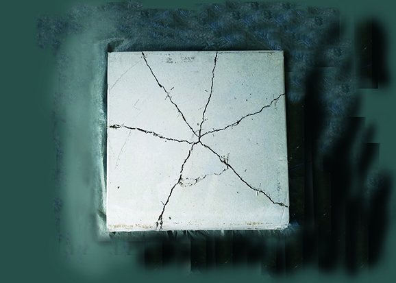 Fiber reinforced concrete test slab after extreme impact test.